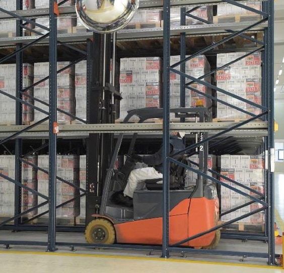 Forklift Inside Drive-in/Drive Thru Racking in a Warehouse