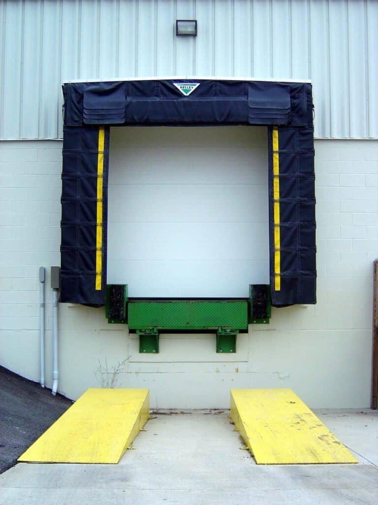 Dock Door With Dock Leveler