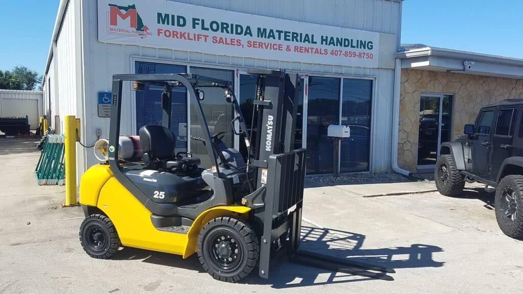 Komatsu Forklift in front of Mid Florida Material Handling Storefront