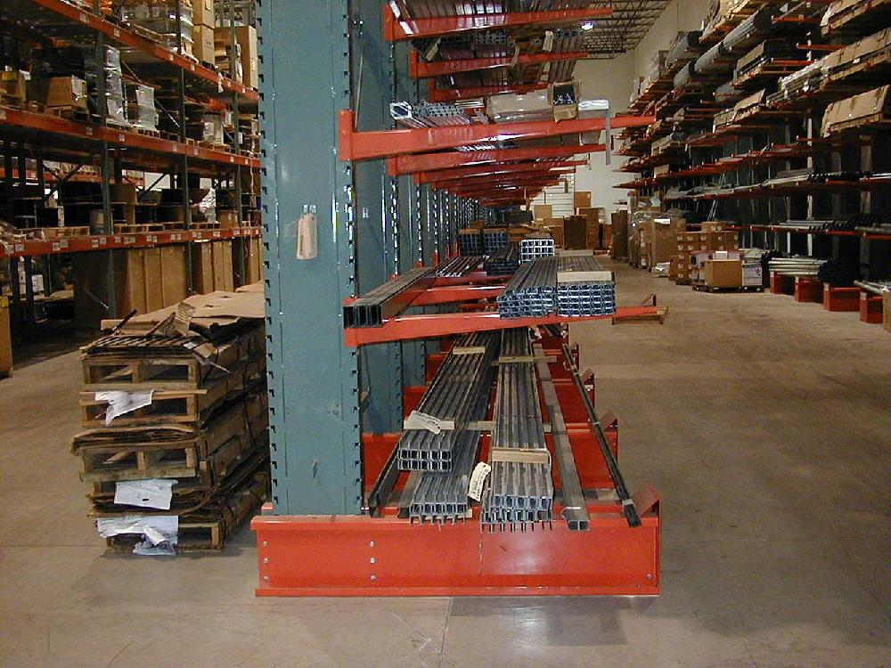 interlake cantilever pallet rack with green uprights and orange beams