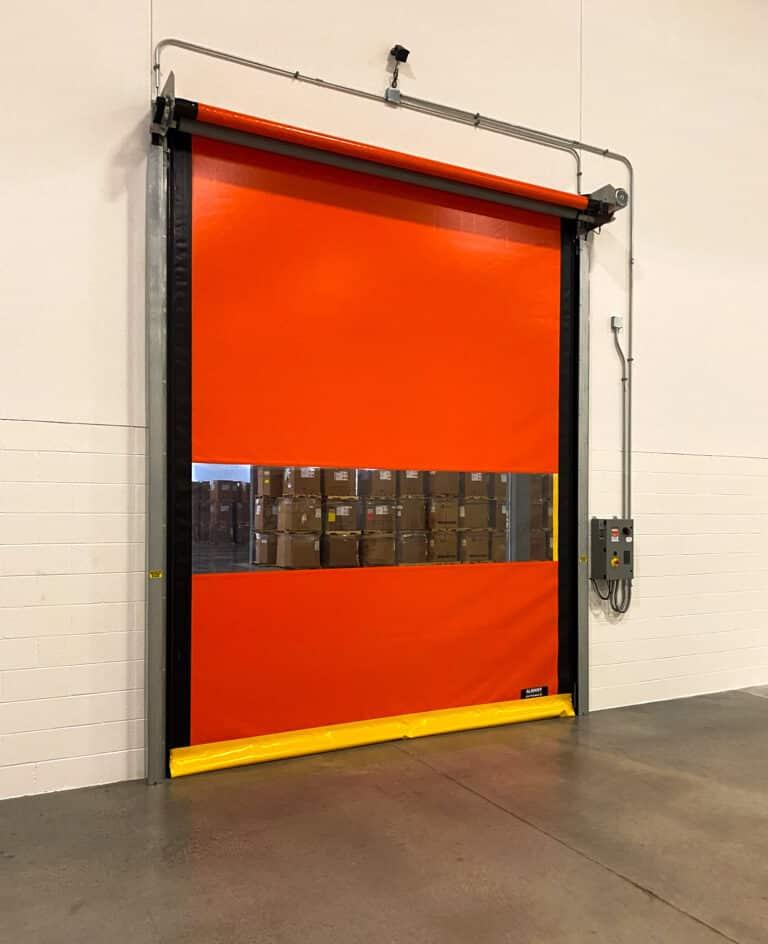 Orange high speed doors with a yellow bottom seal on door